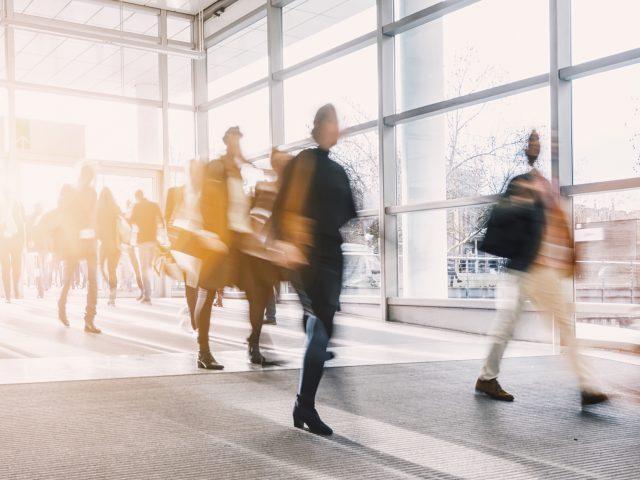 Group of people walking down a hallway