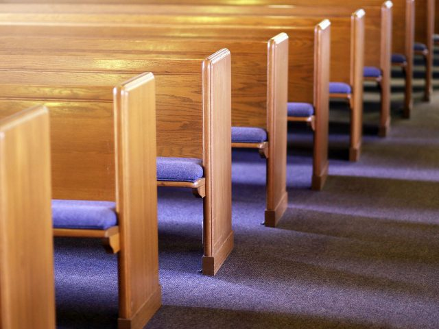 Close up image of empty church pews