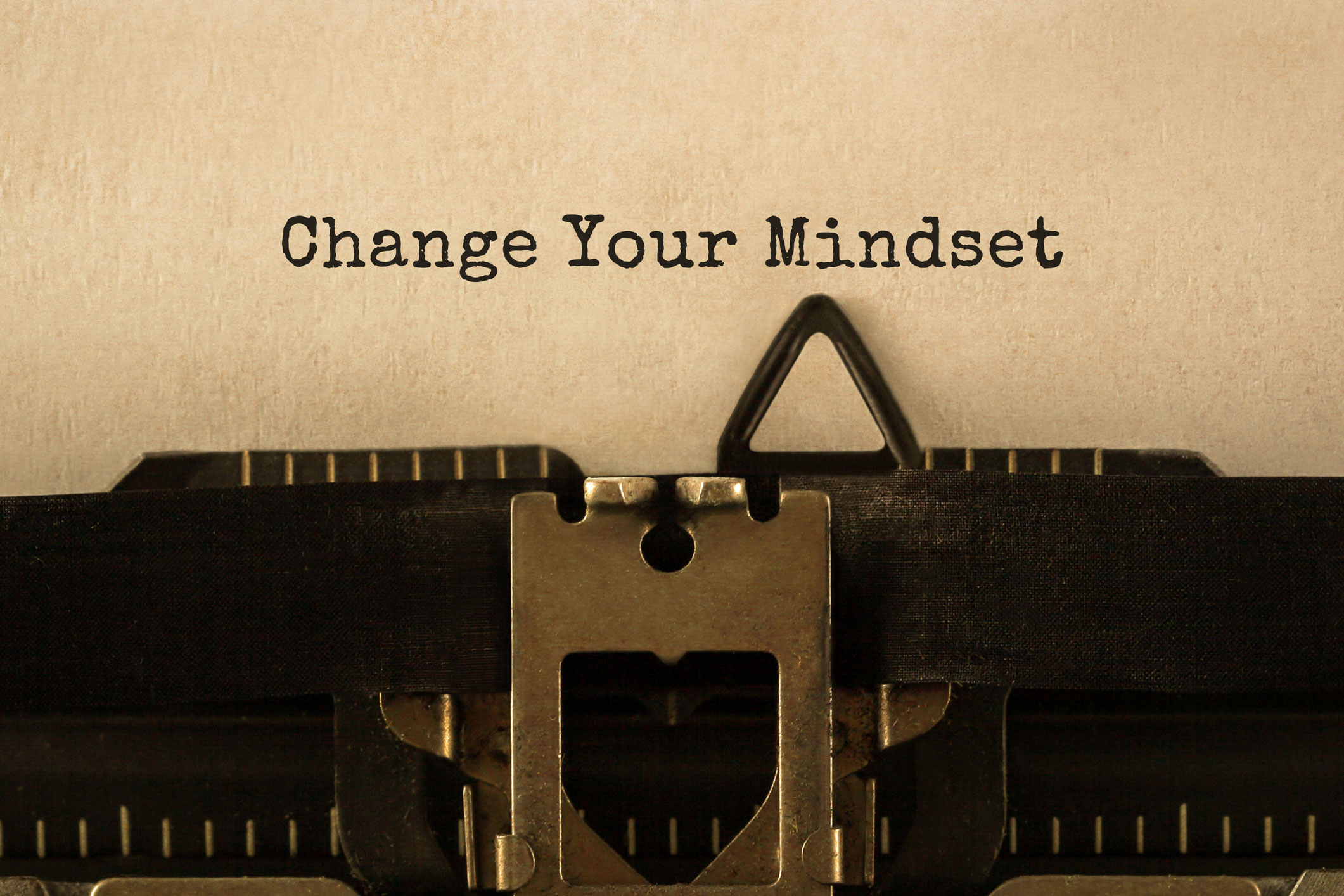 Paper on typewriter with the words 'Change Your Mindset' typed