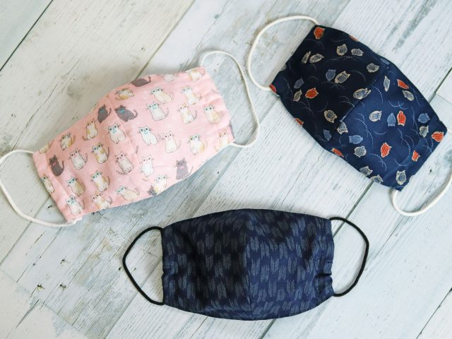 Handmade patterned and cat patterned fabric face masks for virus contagion protection - stock photo