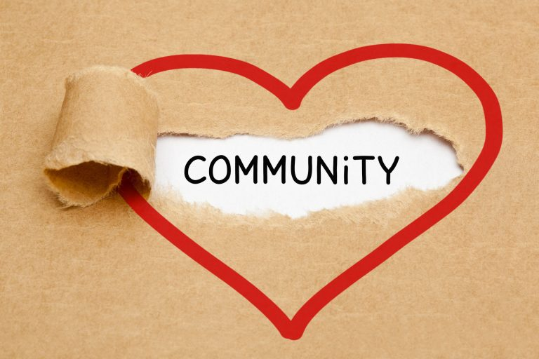 Community Ripped Heart Paper Concept - stock photo