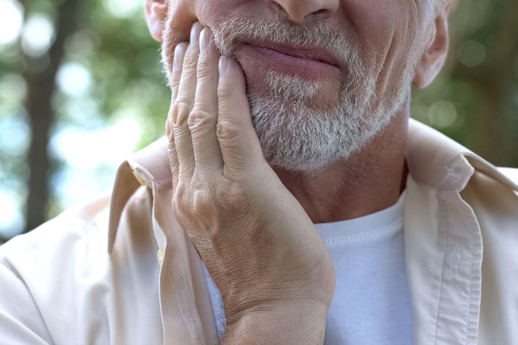 Senior man having problem with teeth,