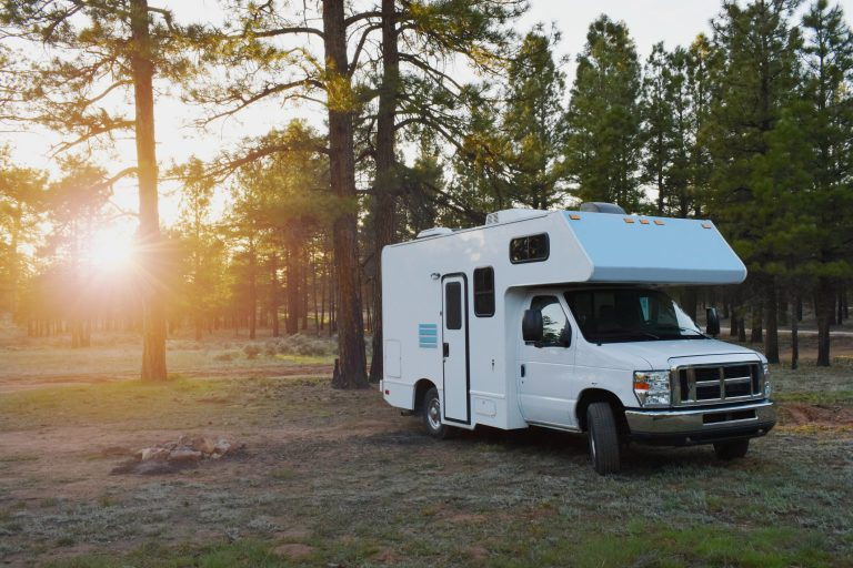 Camper vehicle on free campsite in the wildernest within sunrise
