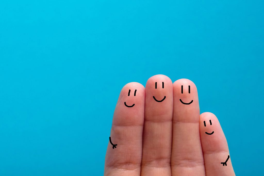 four smiling fingers that are very happy to be friends - stock photo