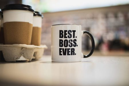 A coffee mug with best boss ever printed on it. - stock photo