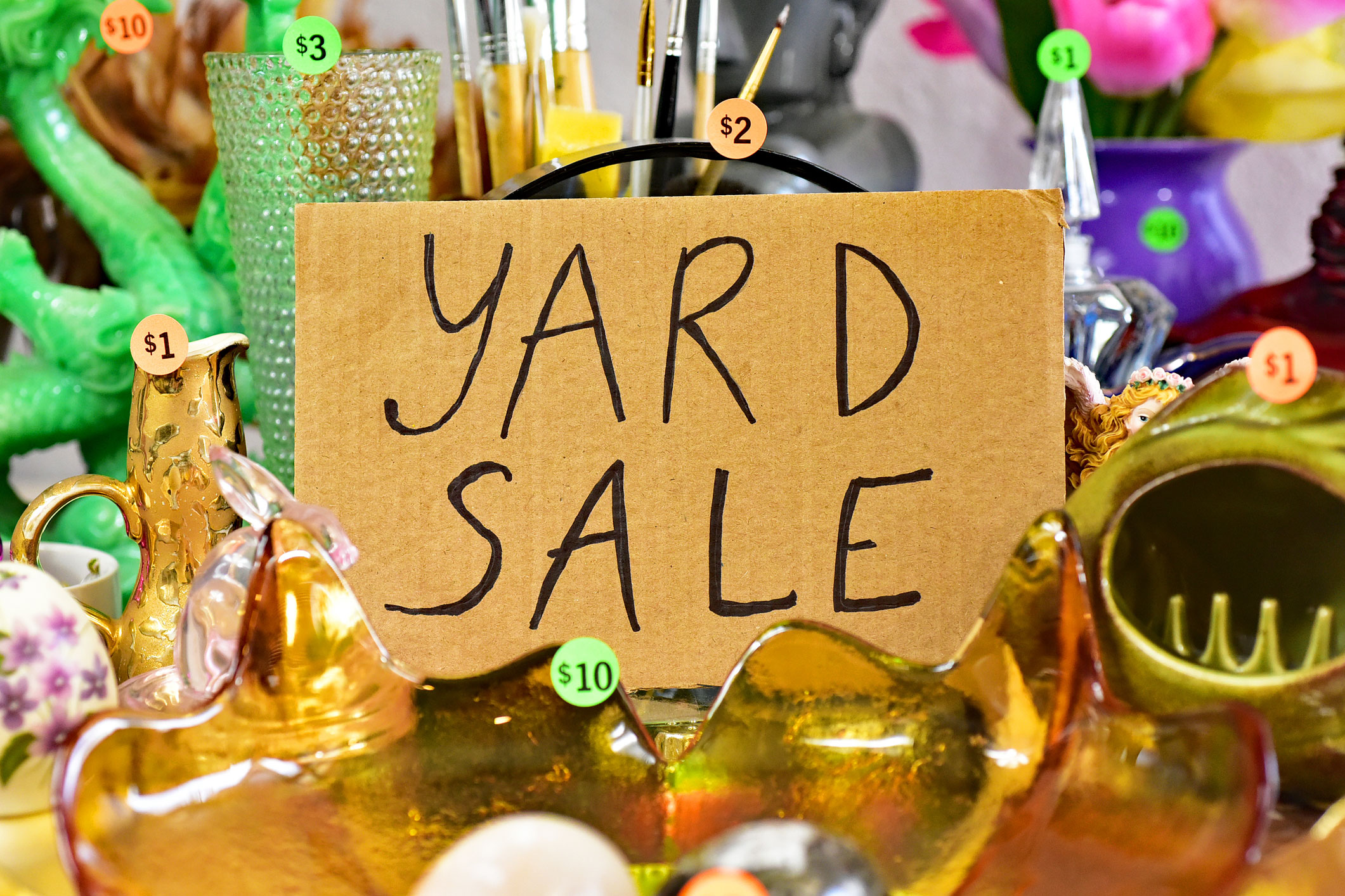 Garage sale yard sale sign with items on a table - stock photo