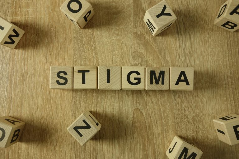 Stigma word from wooden blocks
