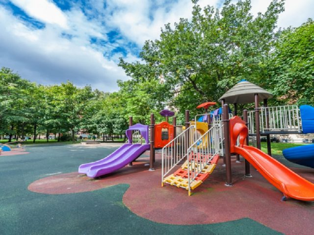 colourful playground equipment set shown in park