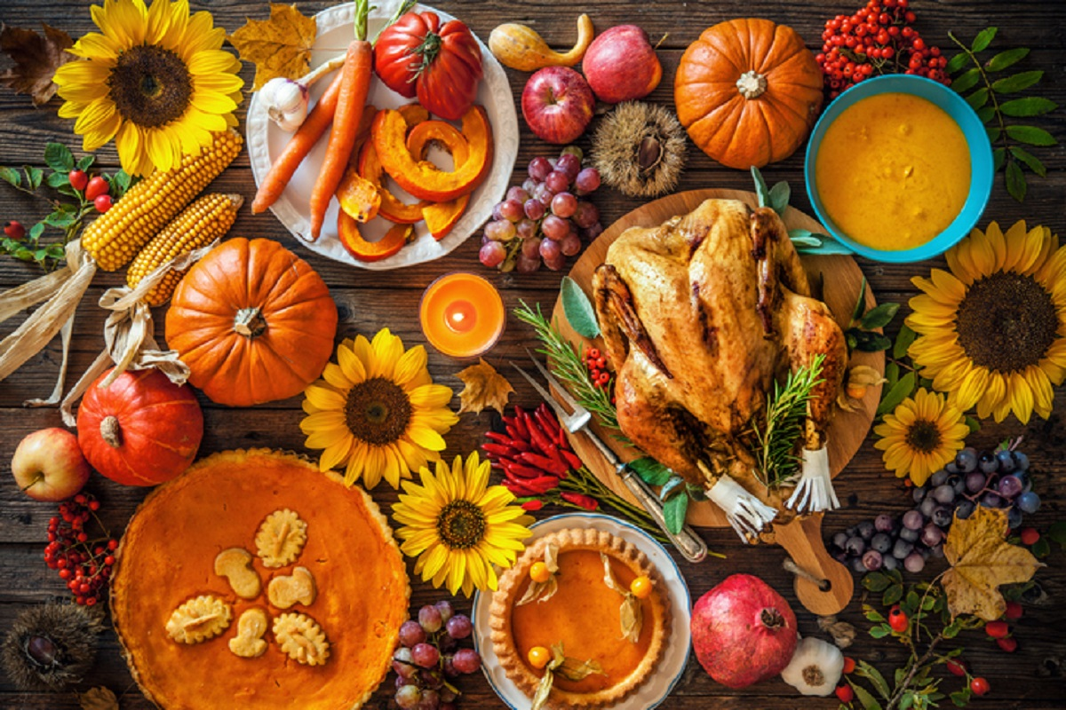 table filled with Thanksgiving turkey and fixings