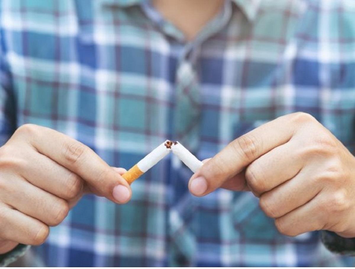 Person snaps an unlit cigarette in half