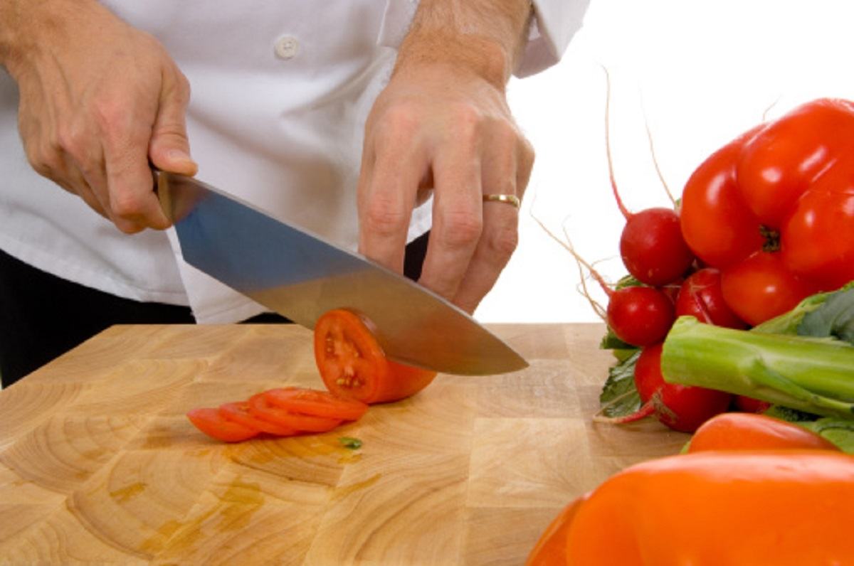 Person chopping vegetables and preparing food