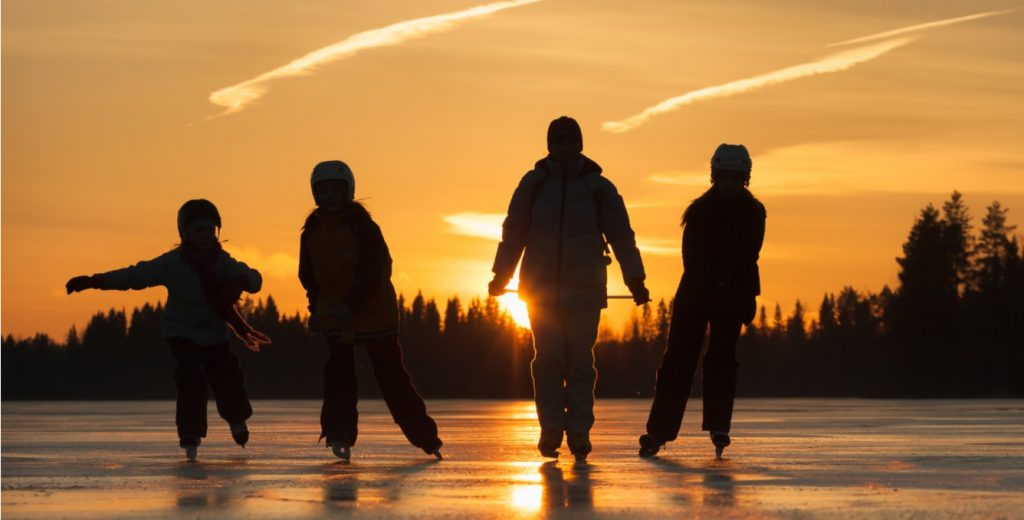 image of family skating on outdoor ice rink