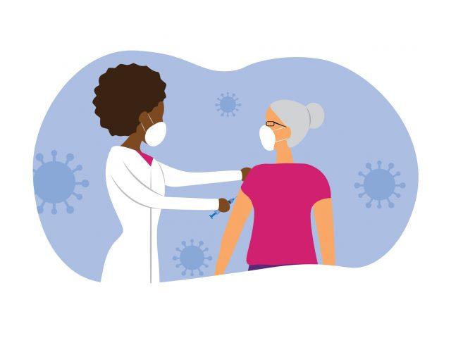 health care provider gives COVID vaccine