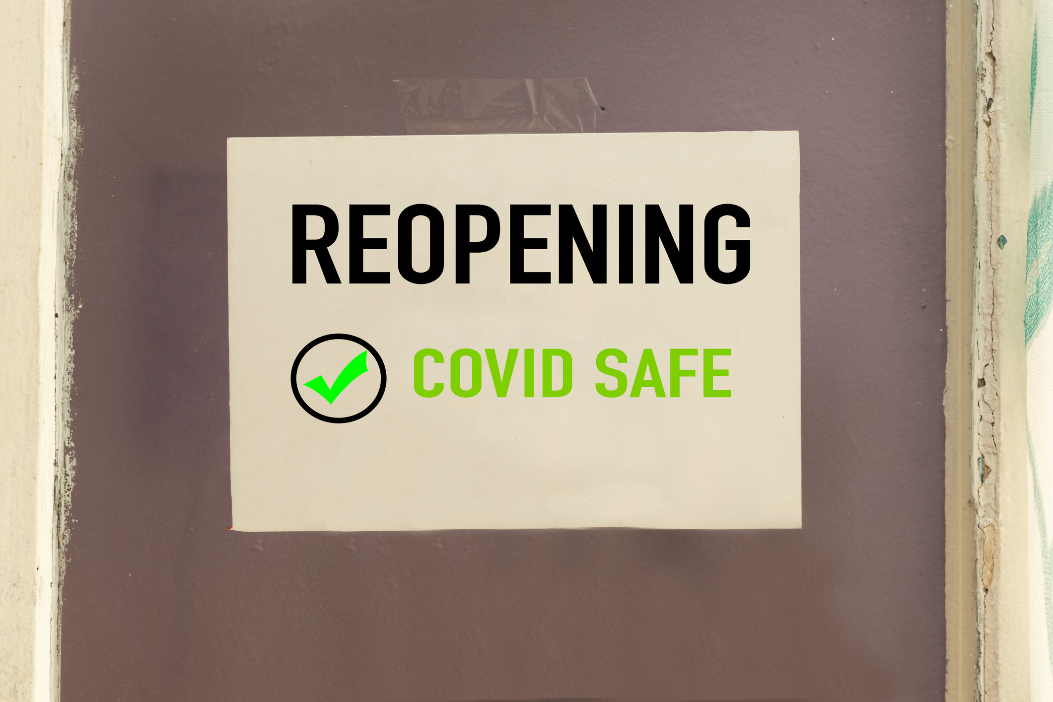 sign that says Reopening COVID Safe